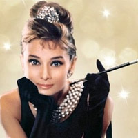 Audrey Hepburn helped popularize the high-bosomed, sleeveless dress in 1962